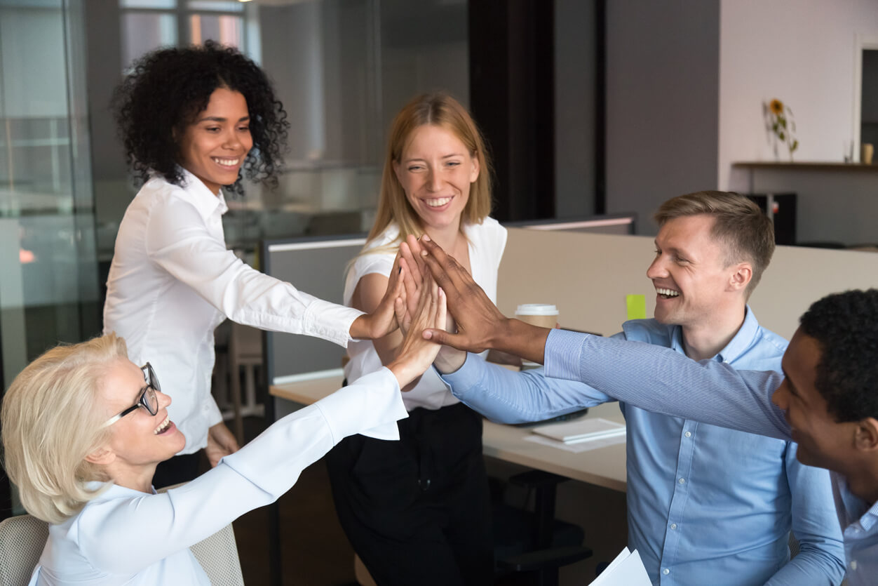 Happy employees working as a team.